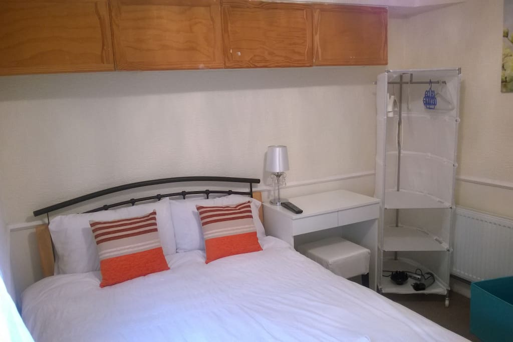 Double bed room with desk and wardrobe facilities