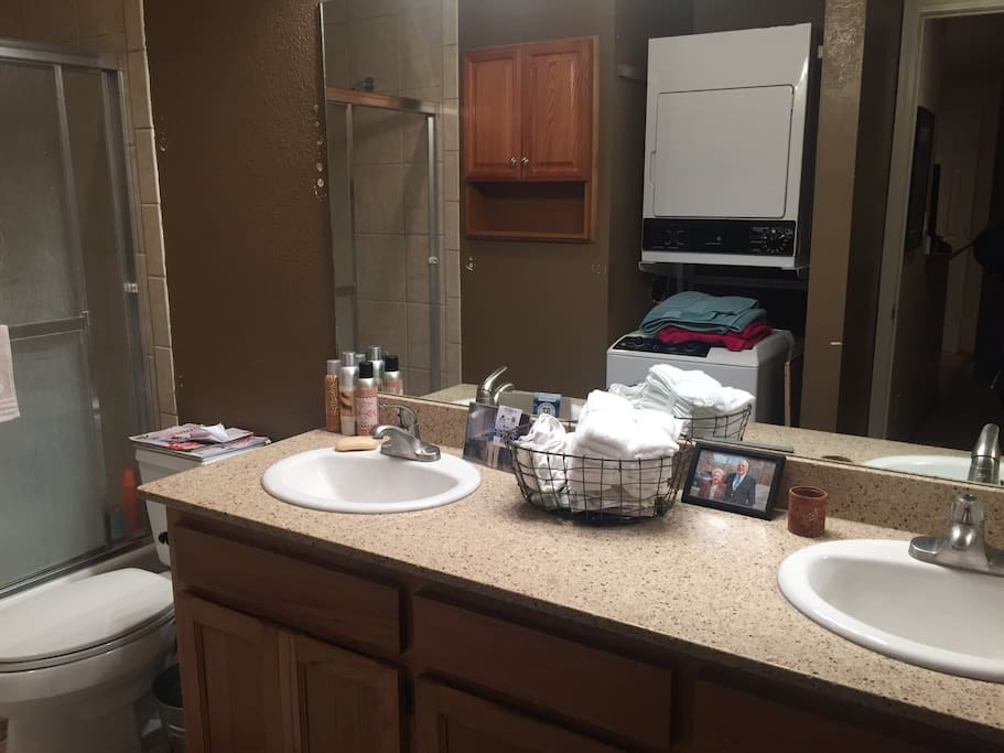 Full bathroom with washer and dryer