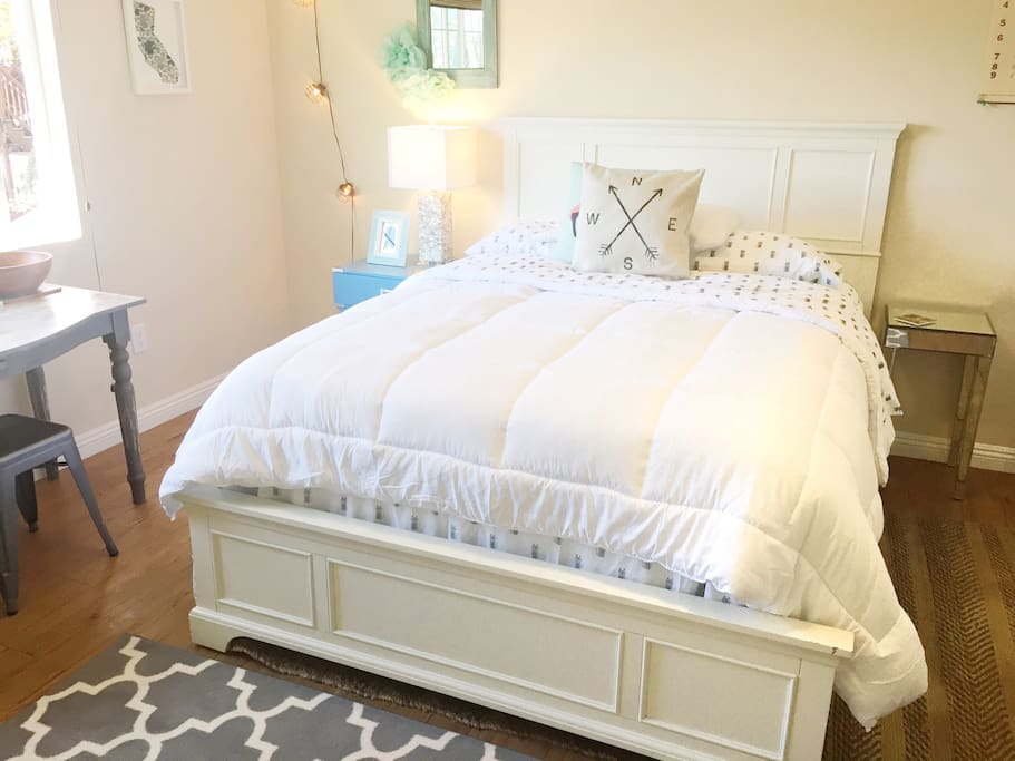 Queen bed from Tufts and Needle in the bedroom.