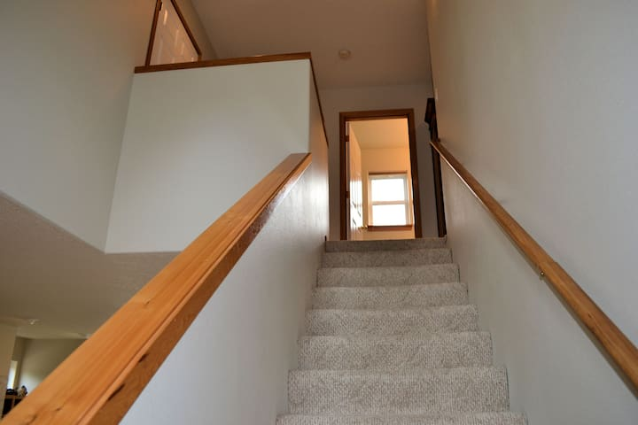 Stairs going up to the second floor bedrooms