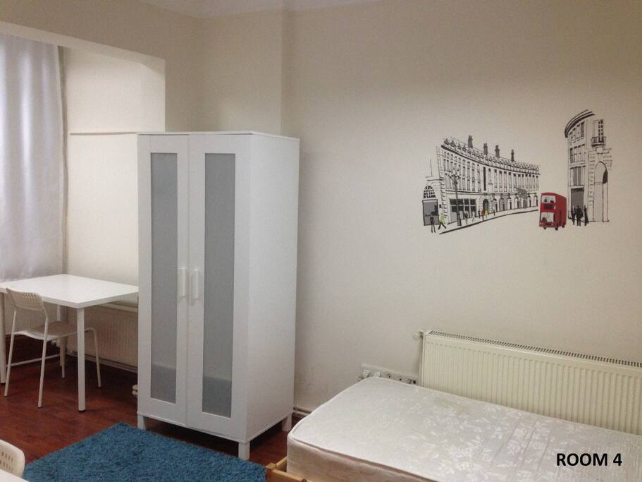 ROOM 104 is a big room having 1 double size bed, 2 wardrobes, 2 desks and 2 chairs. In the photos there are 2 single beds but they can be replaced by 1 double size bed in the case of demand.