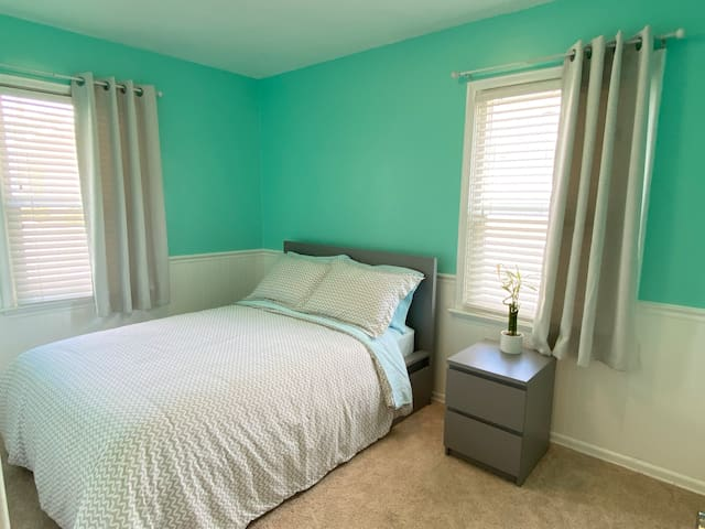 Second guest bedroom with full size bed with under-bed storage and a nightstand. There is a small closet not pictured.