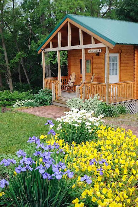 Enjoy views of the flower gardens from your front porch.