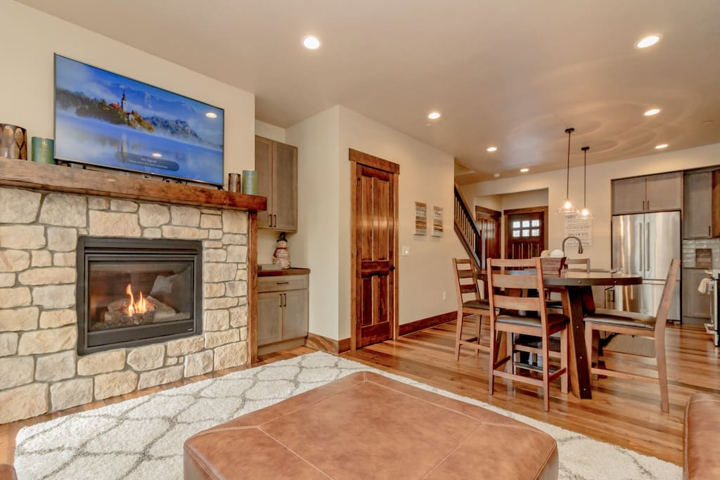 Fantastic open concept great room with a gas fireplace and Smart TV with Dish.