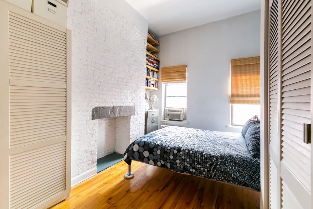 The bedroom. Painted brick, wooden floors, comfortable bedding, its own bathroom.