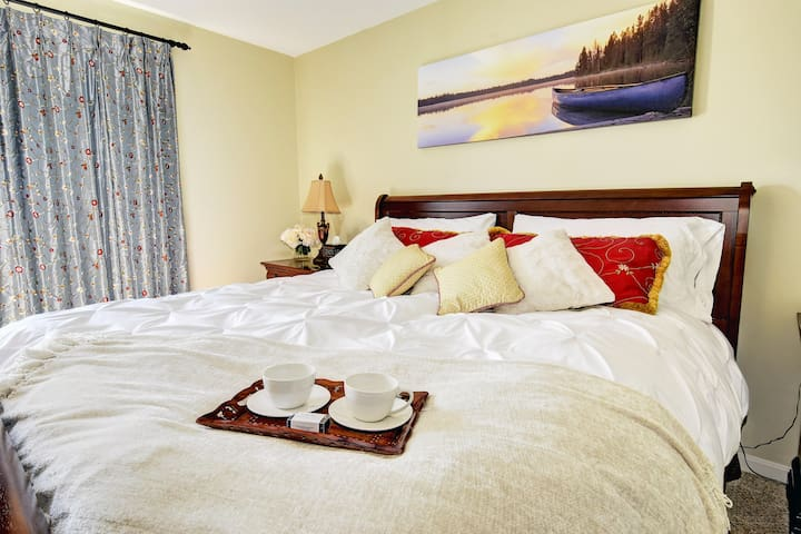 Relax in the Master Bedroom on the king sized bed!
