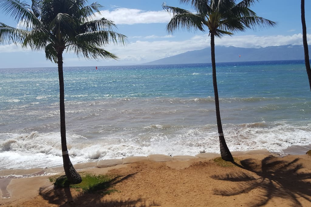 Our winter beach  even with some sand bags due to the surge.... View from our lanai