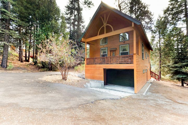 Dog-friendly home in a great location w/ game tables, covered decks, & more!