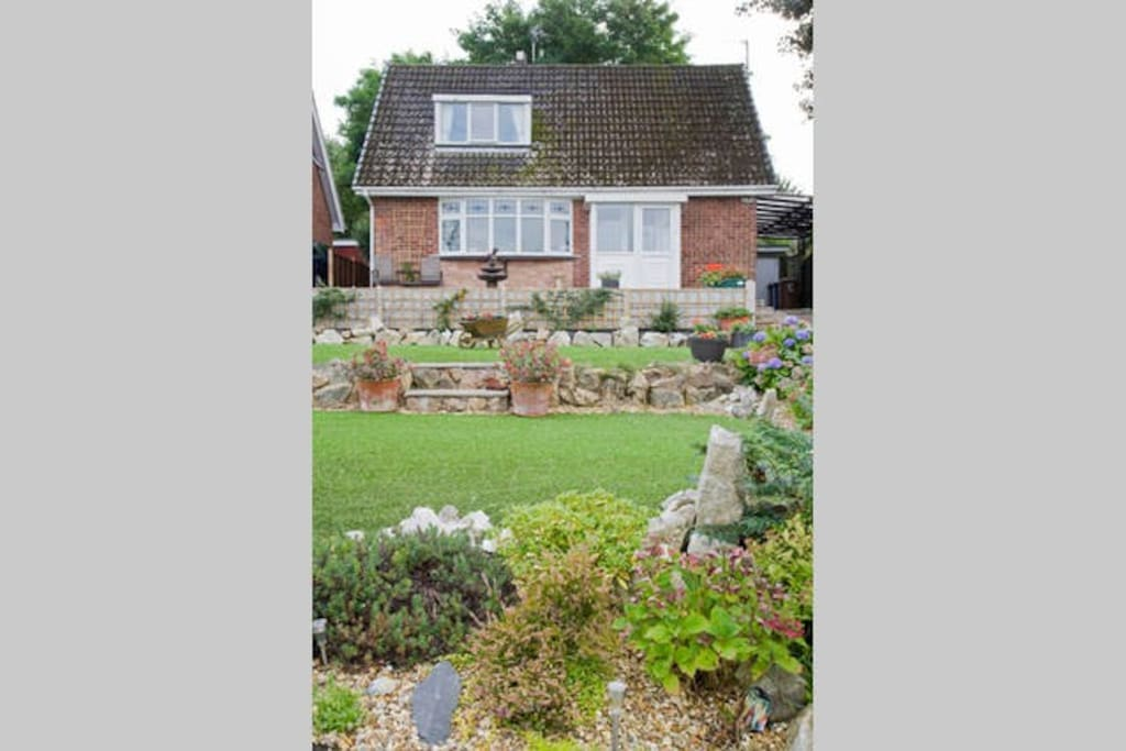Our home with front landscaped garden.