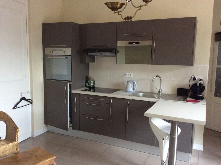 Fully fitted kitchen with oven, induction hob, microwave and full-size fridge