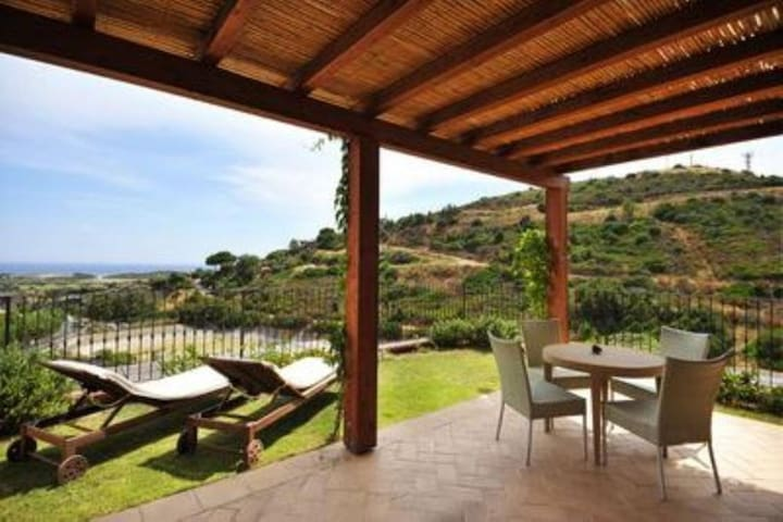 "Tranquil ""Villa Gaia Chia"" with Veranda, Sea Views & Air Conditioning; Parking Available"