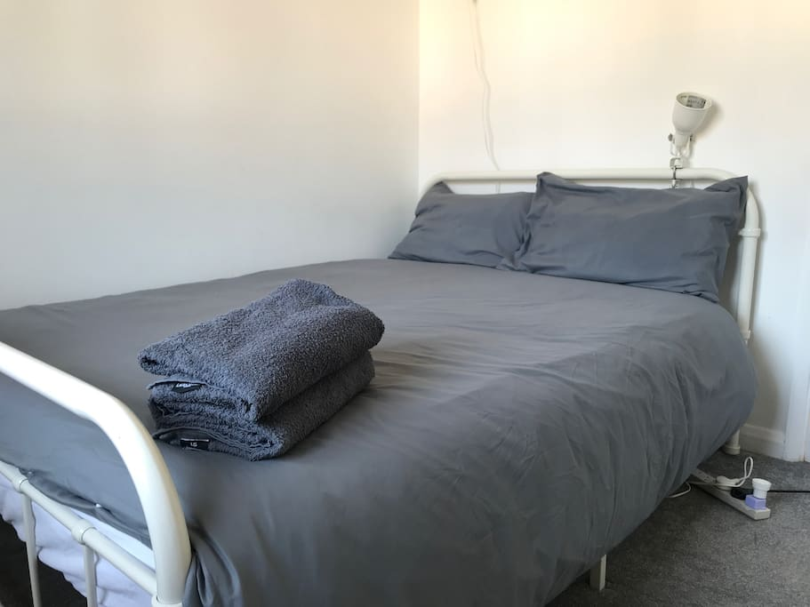 Big double bed for second bedroom with fresh linens and towels provided