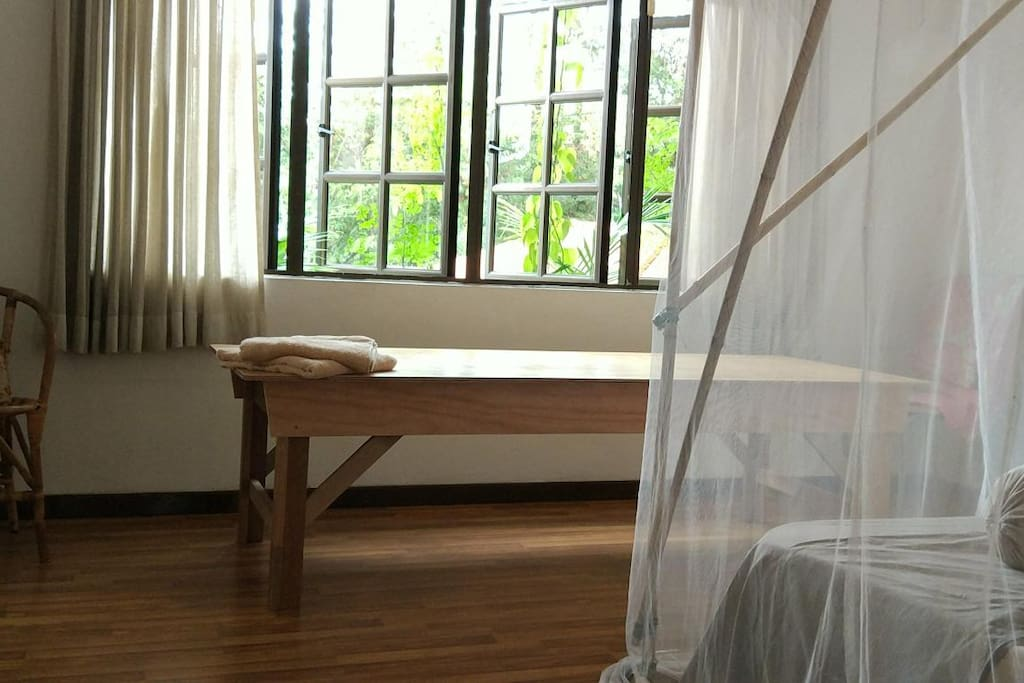 Room #1 Master Bedroom with 3' by 7' wood platform, mosquito net, ceiling fan ...