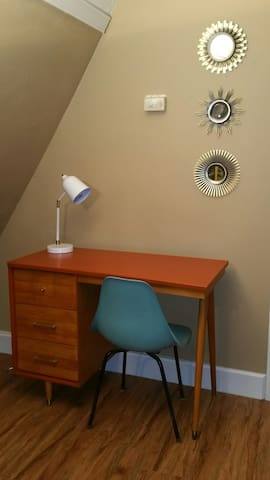Classic workstation close to power with retro formed  fiberglass chair.