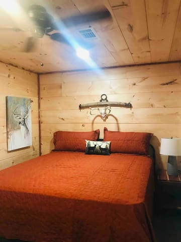 King bed in private bedroom with ceiling fan. Sheets/blankets/pillows provided.