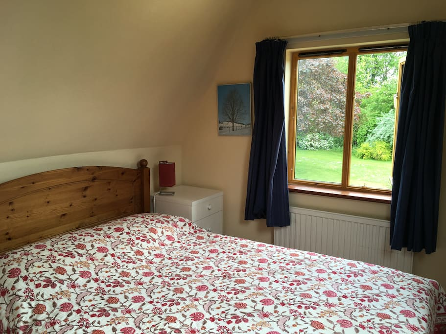 Double bedroom with lovely views over a private garden and church
