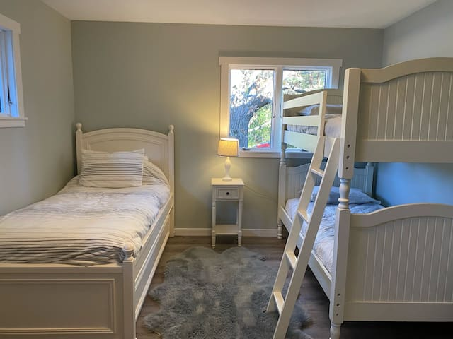 Upstairs bedroom with bunkbeds and twin over trundle