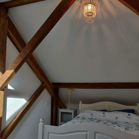 Bedroom 1 is a spacious attic room.
