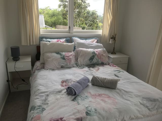 This shows the second bedroom which gets a lot of sun and can be really warm.
