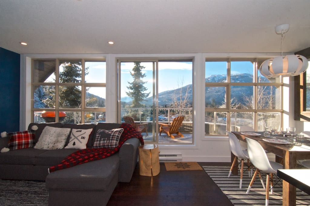 Large windows with plenty of natural light and endless mountain views