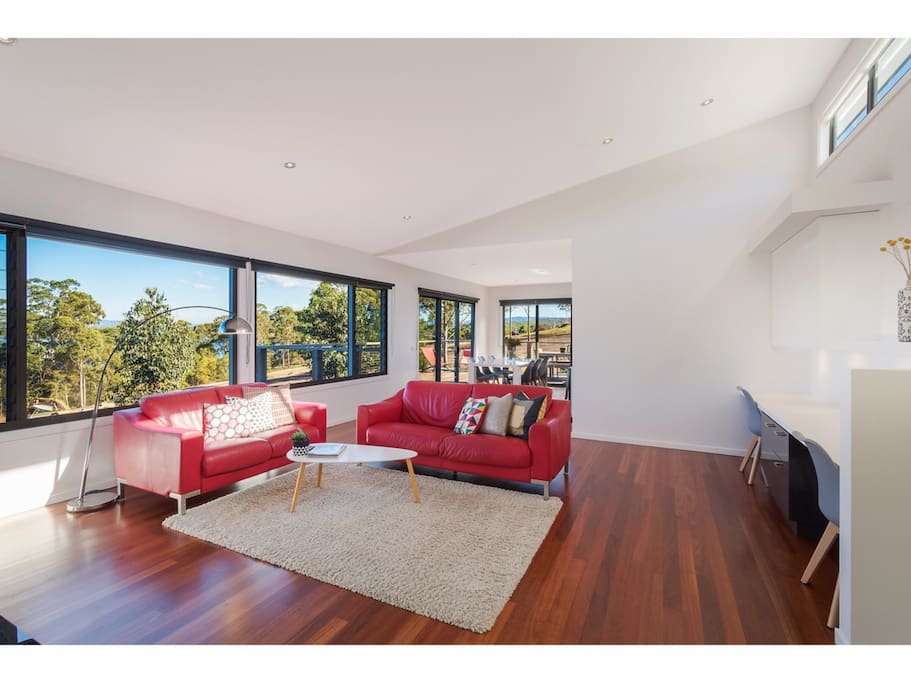 Lounge room and study nook. Leather lounges and polished blue gum timber floor.
