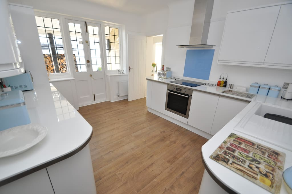 Brand New Kitchen with all Integrated Appliances leading to Veranda