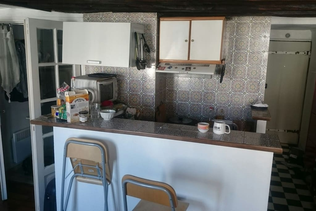 Kitchen with coffee machine and all utensils