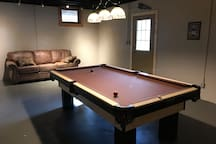 Pool Table and Sofa in basement