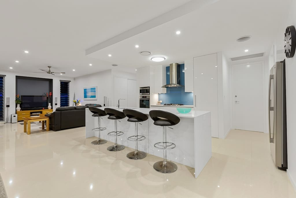 open plan kitchen dining lounge room