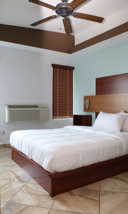 Double Room with TV, A/C, Ocean View, Microwave, Fridge, 2 Queen bed & living room.