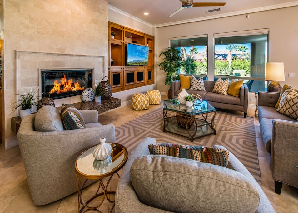 Comfortable living room with tons of seating and fireplace