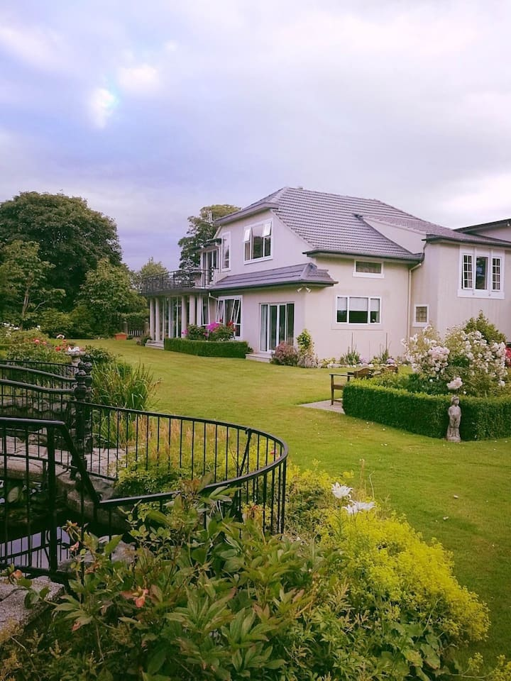 View of the house from the garden, all rooms look over the garden and farmland beyond
