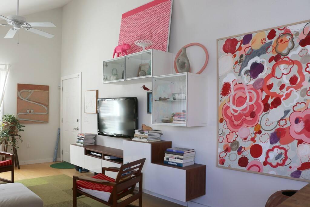 Living Room full of orginal art and a tv!