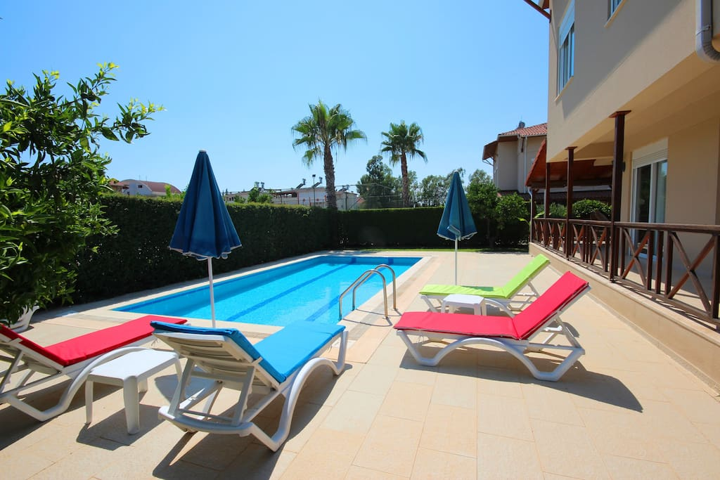 Villa Pool Deck very private with sunbeds/parasols. Direct access from Lounge.