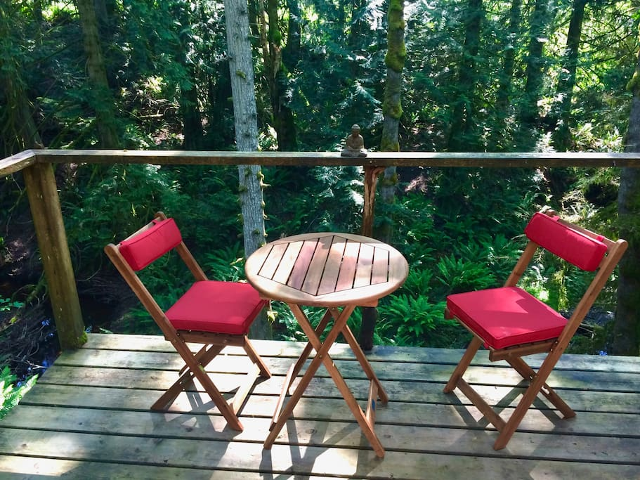 Enjoy the a glass of wine on the deck perched high above the creek