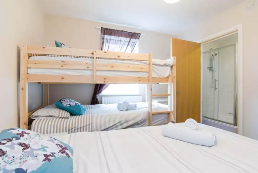 Bedroom 2: Two bunk beds and one single bed (maximum 3 people). Door leading to en-suite bathroom.