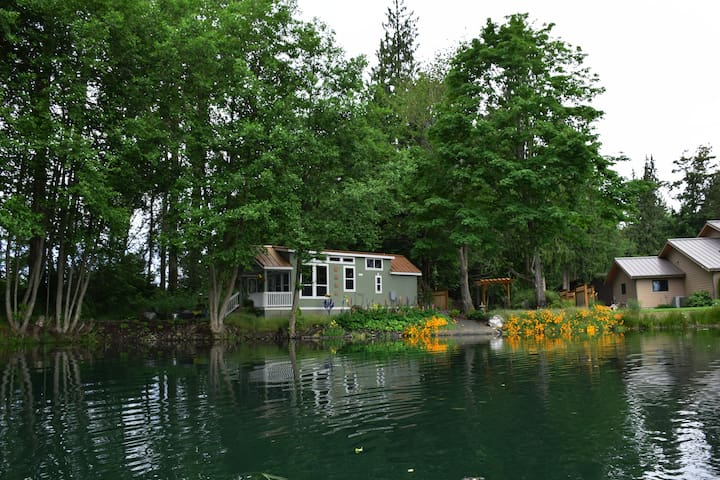 The tiny house is perfectly tucked away in its own little oasis, yet we are close enough should you need anything.