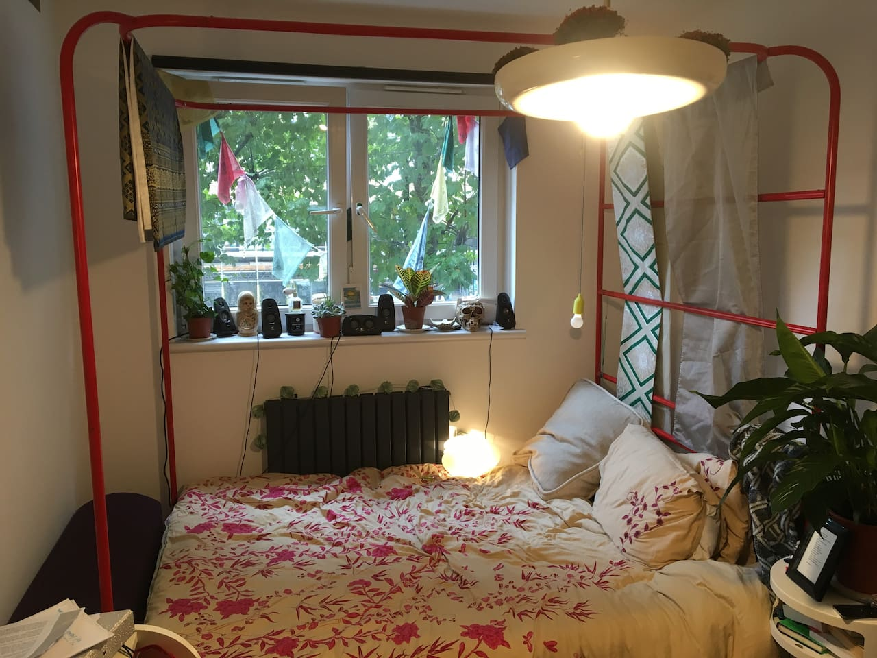 Master bedroom, home to you, a red four poster bed, more plants you can shake a stick at (even the ceiling light is a plant pot!), and USB charging :)