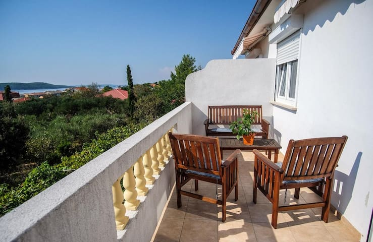Two bedroom apartment with balcony and sea view Barbat, Rab (A-14431-b)