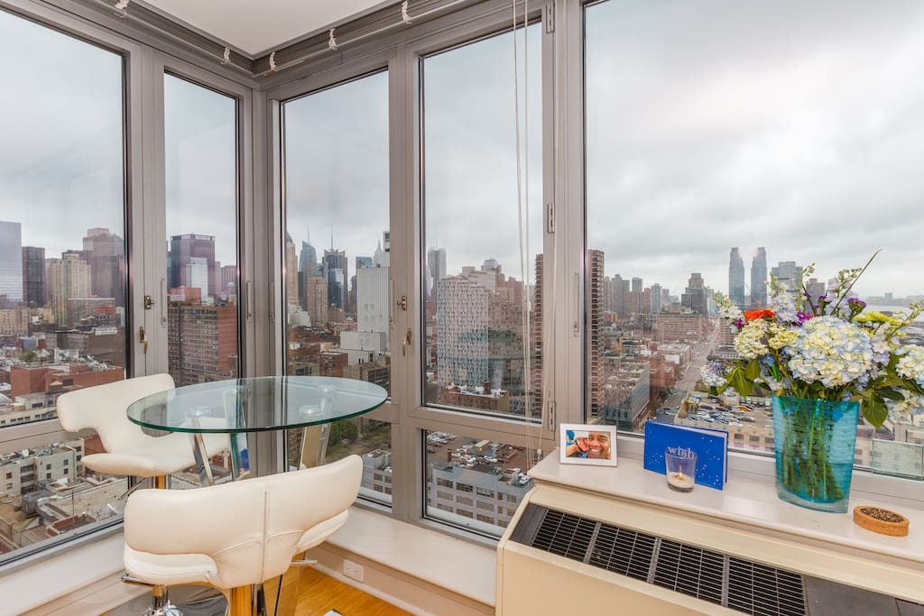 Corner unit offers side city views and Hudson views with floor to ceiling windows.