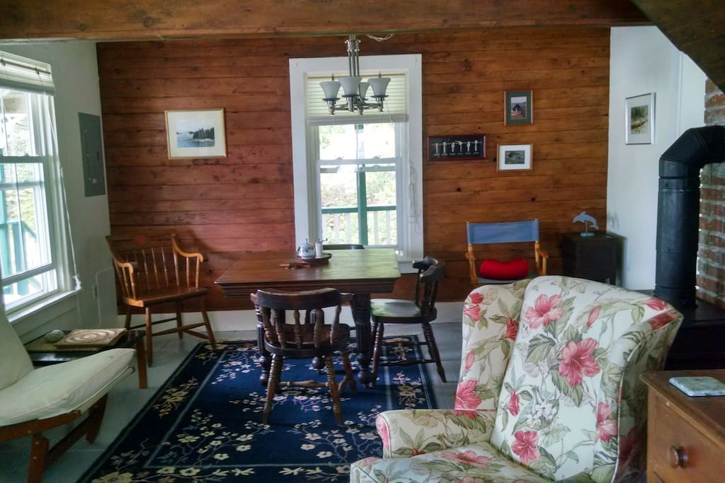 Dining area. The wood wall is the original paneling from when this was the Superintendent's office for the first quarry in Stonington in the 1890s.