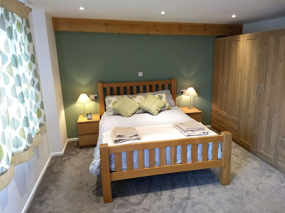 The bedroom, King size solid oak bed, large wardrobes. Bedside USB charging ports.