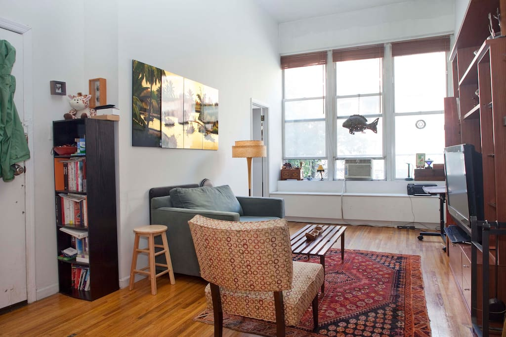 Main living room with great picture windows looking over 72nd st. It's like living outside a New York Aquarium.