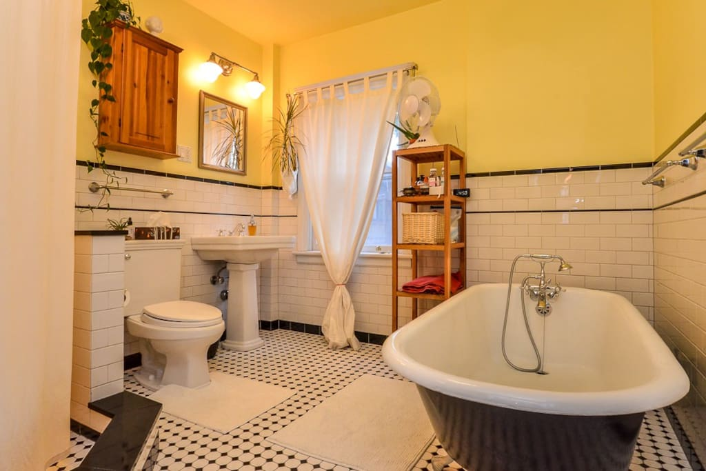 Bathroom with clawfoot tub and shower on the left. The medicine cabinet is for your use.