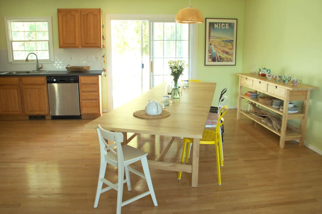Open-layout kitchen w/ living room and dining area w/ 12 person dining table