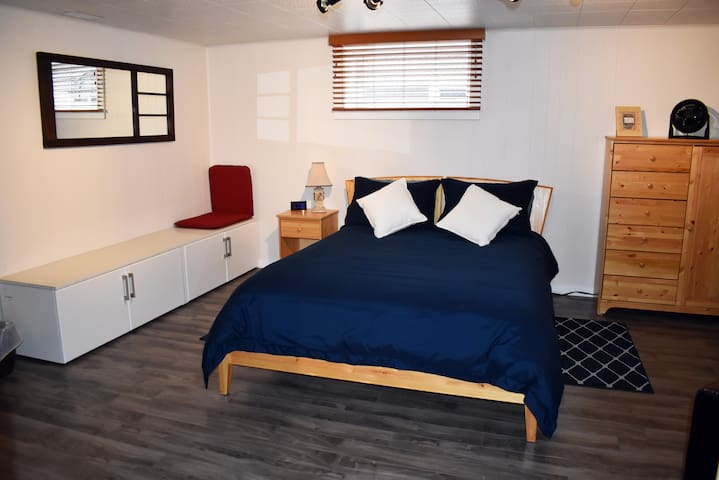 """Queen sized bed in """"Megan's"""" room with sitting chair too! (Bedroom # 1)"""