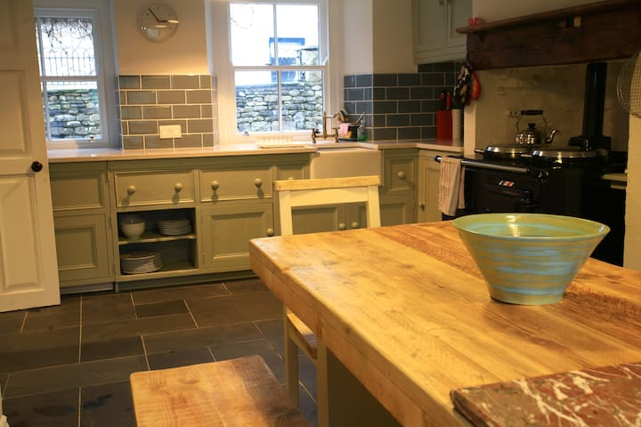 Country-style kitchen with oak-beams and electric Aga.