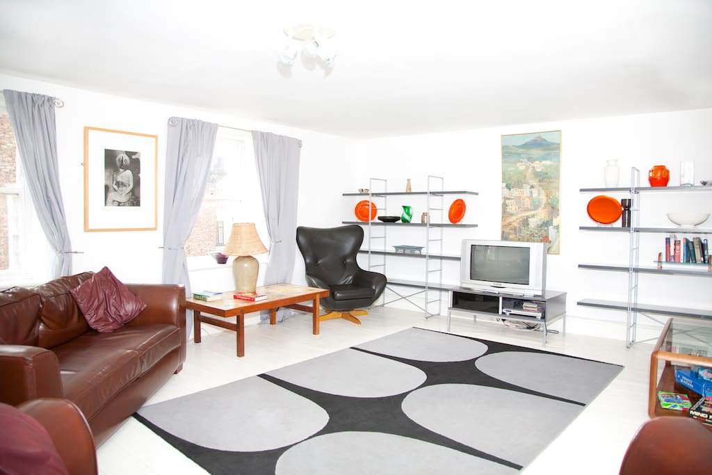 Living room with squashy leather sofas and retro accessories