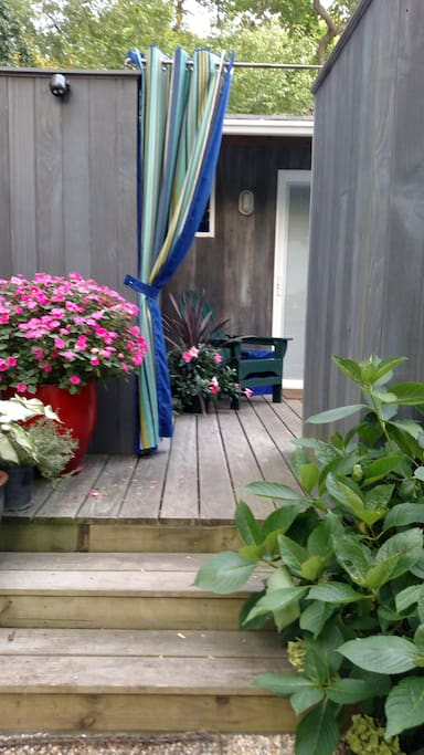 Enter the cottage via your own private deck - The entire property is private and secure, just set back with a good book and enjoy the tranquility.