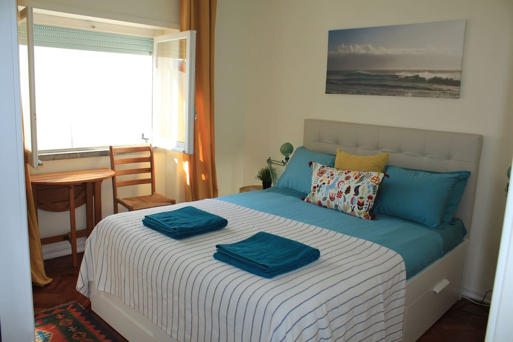 Double bedroom with blue bed linen